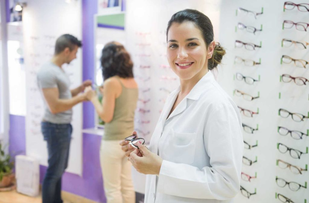 Optician helping patient choose the right children's glasses