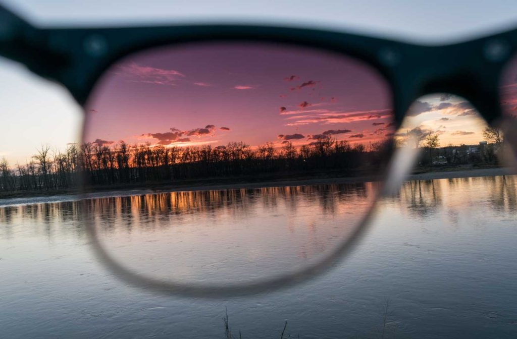 polarized sunglasses filtering glare off the surface of water and trees